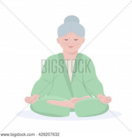 An Elderly Lady Does Yoga, Sits In The Lotus Position, Meditates. The Concept Of Concentration, Calm
