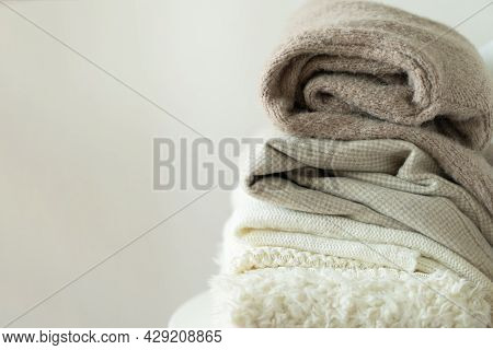 Pile Of Knitted Sweaters. Warm Background, Knitwear, Space For Text. Autumn Winter Concept. Backgrou