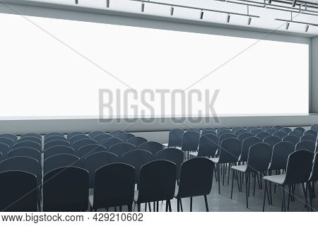 Luxury Grey Auditorium With Seating And Empty Screen With Mock Up Place For Your Advertisement. Show