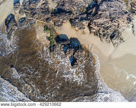 Aerial View Of Sand, Waves And Rocks At Torres Beach, Torres, Rio Grande Do Sul, Brazil