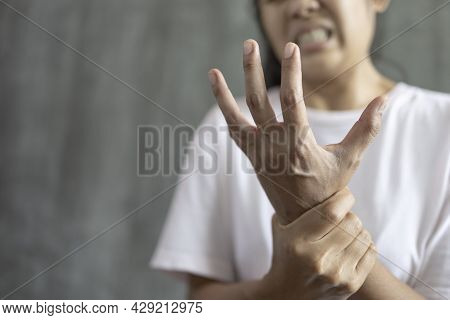 Close Up Young Woman Wrist Pain,  Office Syndrome, Health Care Concept, Concept Of Guillain Barre Sy