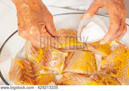 Fish Marinade Preparation Steps: Seasoning The Sea Bass Pieces