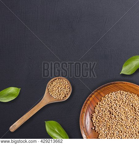 Sinapis Alba - Organic White Mustard Seeds In Wooden Bowl And Spoon