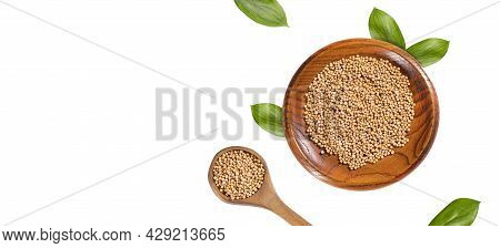 Organic White Mustard Seeds In Wooden Bowl And Spoon - Sinapis Alba