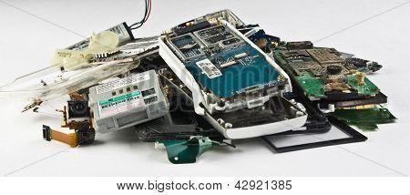 Broken phones, dumped a bunch on a white backgroud.