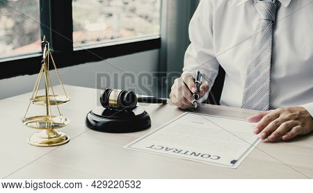 Businessman Hand Sign Contract After Lawyer Providing Legal Consult Dispute.