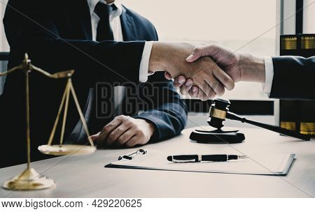 Handshake After Lawyer Providing Legal Consult Business Dispute Service To The Man At The Office Wit