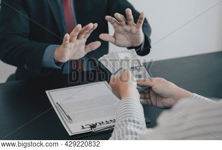 Businessman Hand Give Bribe To The Government Officials Who Refusing Money, The Concept Of Corruptio