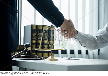 Handshake After Lawyer  Providing Legal Consult Business Dispute Service To The Man At The Office Wi