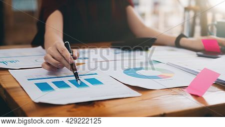 Close Up Of A Female Accountant Or Banker Checking Investment Results, Calculates Financial Savings,