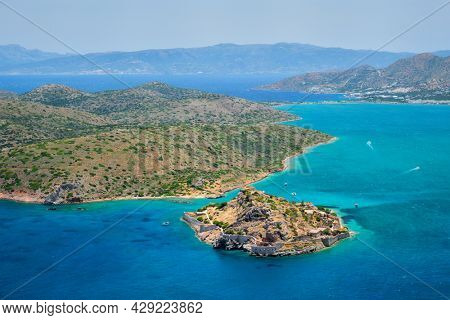 Island of Spinalonga with old fortress former leper colony and the bay of Elounda, Crete island, Greece