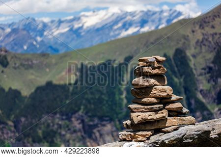 Stone cairn in Himalayas with mountains in background. Near Manali, above Kullu Valley, Himachal Pradesh, India