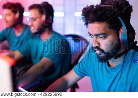 Head Shot Of Gamer Talking On Headphones While Playing Live Streaming Game Or Esports Tournament - C