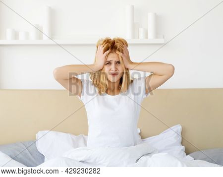 Hangover Headache. Overslept Woman. Insomnia Struggle. Unhealthy Rest. Frustrated Sad Lady In Bed Wi