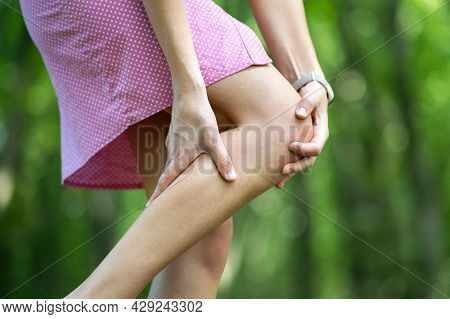 Woman Holding Her Knee With Hands Having Joint Pain.