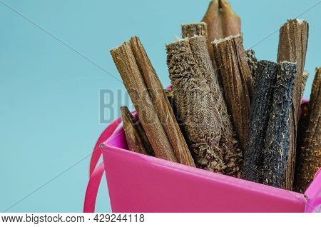 Box Of Treats On A Blue Background. Dried Dental Goodies For Puppies, Adult Dogs And Seniors Dogs. D