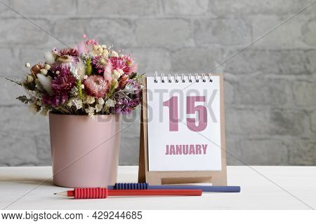 January 15. 15-th Day Of The Month, Calendar Date.a Delicate Bouquet Of Flowers In A Pink Vase, Two