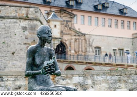 July 2021, Erfurt Germany, Man With An Animal, A New Sculpture In Erfurt In The Rain