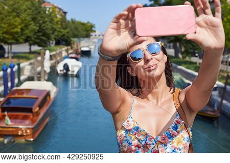 woman in summer vacation in venice Beautiful woman in vacation in venice. Beauty Woman in vacation in venice. Beautiful woman in vacation. woman in summer vacation in venice. young woman portrait in venice. Woman arrived in vacation in venice. Woman in va