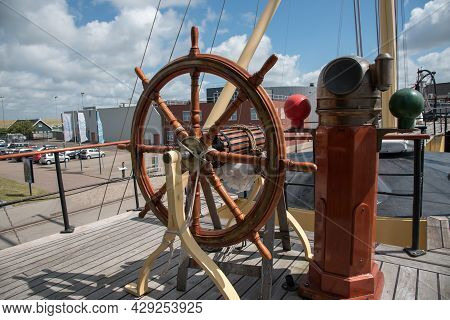 Den Helder, The Netherlands. August 2021. Rudder And Compass Of An Old Warship In The Harbor Of Den