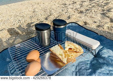 Travel Food For Outdoor Activities. Two Metal Thermo Cups, Eggs And Toast On A Summer  Background. E