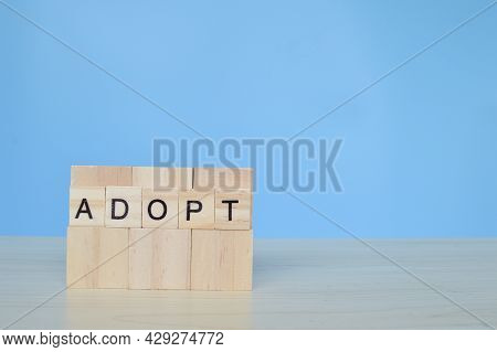 Wooden Cube Blocks With Text Adopt. Family Concept