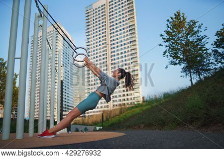 Mid Adult Woman Doing Exercise Outdoors In City, Healthy Lifestyle Concept.