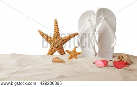 Bright Flip Flops, Starfishes, Sea Shells And Sunglasses On Sand Against White Background
