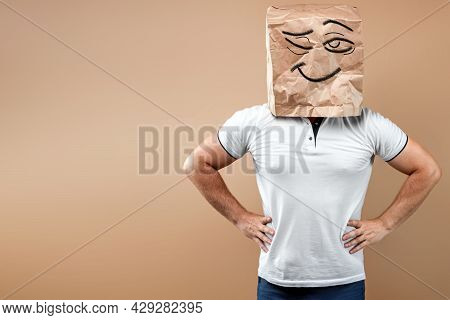 Men Put A Paper Bag With A Winking Painted Face On Their Heads, Keep Their Hands On Their Belts. Iso