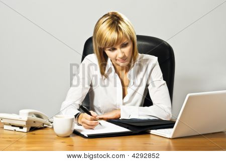 Beautiful Business Lady At Desk