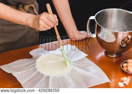Woman Beaker Preparing Cake Mix Dough In Form For Baking Tin