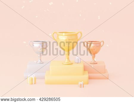 Three Trophies: Gold, Silver And Gold-plated. A Cup With Gifts And Confetti On A Pedestal.