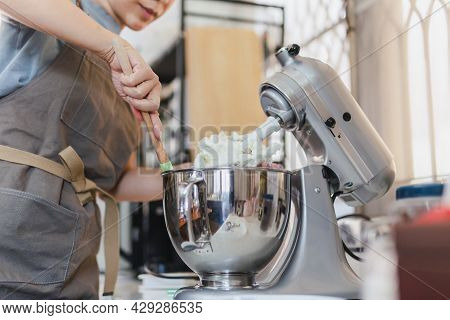Woman Baking Cake With Electric Stand Mixer Machine