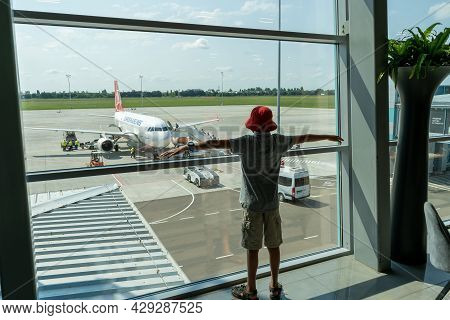 Ukraine, Odessa - August 3, 2021: At The Ods Airport Await Departure. The Plane Is Outside The Windo