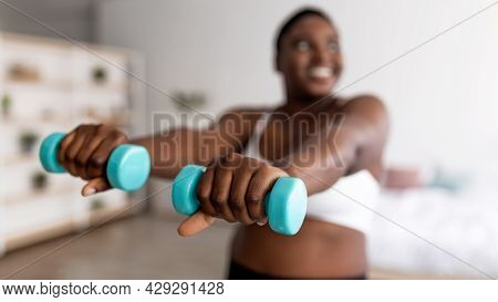Plump Black Woman Doing Exercises With Dumbbells, Losing Weight, Strengthening Her Body At Home, Sel