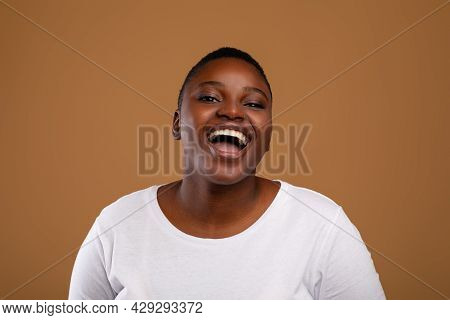 Portrait Of Casual Young Chubby Black Woman Laughing
