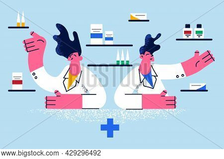 Online Pharmacy And Choosing Drugs Concept. Young Pharmacist Sitting Offering Range Of Drugns Treatm