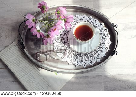 The Concept Of Morning Tea And Viewing The Latest Newspapers. A Newspaper With A Tray On Which There