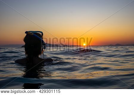 Silhouette Of Woman At Sunset In The Sea. Hydra Island Greece