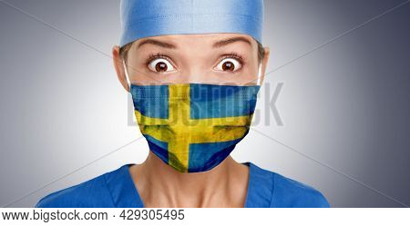 Sweden mask flag Asian doctor woman shocked for Coronavirus crisis help with swedish flag on surgical face cover. Healthcare workers needing PPE during pandemic.
