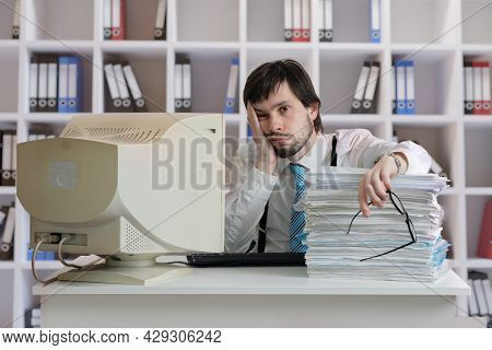 Overworked Tired And Exhausted Man Is Working In Office.