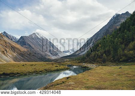 Scenic Autumn Landscape With Mountain Creek In Valley With View To Big Rock With Snow On Top And Bea