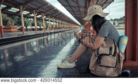Tourist Young Girl Using A Smartphone Checking Travel Map, Online Ticket Check In, Social Media App