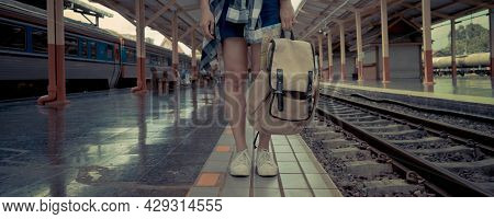 Banner Web Page Or Cover Template. Travel Concept. Woman Traveler Tourist Waiting For The Train With