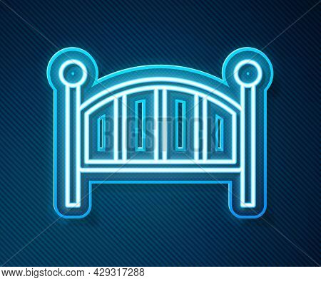 Glowing Neon Line Baby Crib Cradle Bed Icon Isolated On Blue Background. Vector