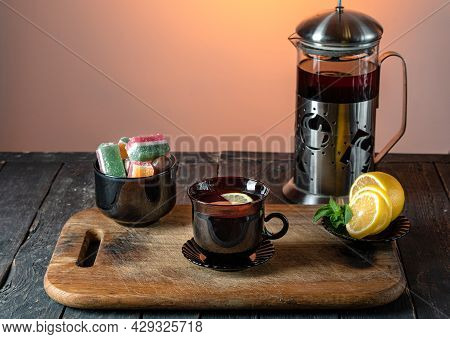 Teapot With Tea. Tea With Lemon And Mint. Tea Sweets. Serving Tea On The Board.