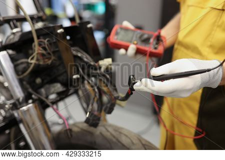 Electronics Repair Service Master Using Multimeter Tester To Determine The Problem Part
