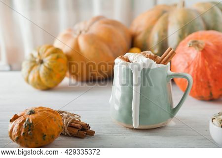 Pumpkin Coffee In Transparent Cup And Whipped Cream With Cinnamon. Autumn Cappuccino Or Latte Menu