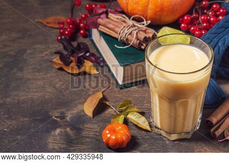 Autumn Or Winter Vegan Drink. Healthy Pumpkin Smoothie In Glasses On A Wooden Rustic Table. Copy Spa