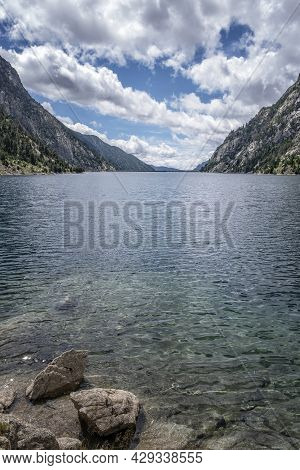 Cavallers Reservoir Surrounded By High Mountains , River Noguera De Tor In Ribagorza, Boi Valley, In